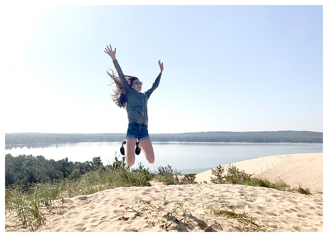 11 Travel Photos - Jumping for Joy at Silver Lake Sand Dunes